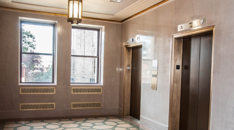custom metal grilles by elevators at The Beacon in Jersey City