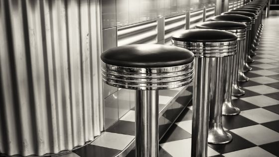 A photo of metal diner stools.