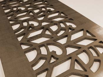 image of metal grille done by either laser or CNC waterjet cutting